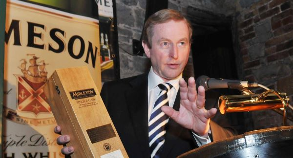 Enda Kenny with a bottle of Midleton  Whiskey during a  visit to the Jameson facility in Midleton.