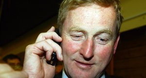 The message of Taoiseach Enda Kenny's latest 'metaphorical' phone call from a member of thepublic is that taxes will be cut to get him re-elected.Picture: Keith Heneghan
