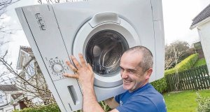 Enda O'Doherty with his washing machine before his walk from Belfast to Waterford to raise funds for Pieta House and to bring awareness to mental health issues and suicide prevention. Picture: Pat Moore