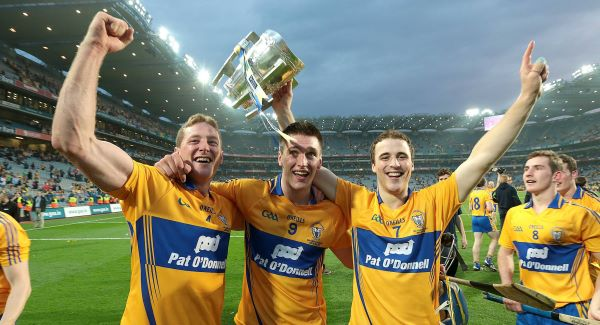Clare's Cian Dillon, Conor Ryan and Patrick O'Connor celebrate with the Liam McCarthy Cup. Picture: INPHO
