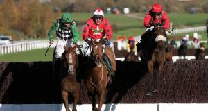 Eventual winner Charingworth, ridden by Harry Bannister, jumps the final fence in third behind Broadway Buffalo and Benbens in the Opus Energy Amateur Riders' Handicap Chase at Cheltenham yesterday. Picture:  David Davies/PA Wire