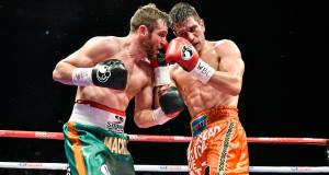 Matthew Macklin, left, exchanges punches with Jorge Sebastien Heiland. Picture: Ramsey Cardy