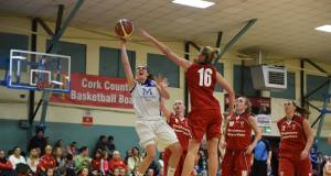 Rosie Tobin (16), Singleton's SuperValu Brunell, tries to block this effort by Jessica Scannell, Team Montenotte Hotel, during the Women's National Cup game at the Parochial Hall, Cork. Picture: Larry Cummins
