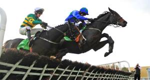 Hurricane Fly (Ruby Walsh, right) clears the last hurdle in front of  Jezki. Picture: Healy Racing