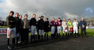 Jockeys pay tribute to the late Dessie Hughes at Punchestown yesterday. Picture: Sportsfile