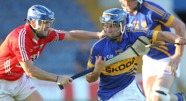Tipperary's Paudie Greene tries to get past Cork's Michael Walsh in last night's Munster IHC final in Semple Stadium. Picture: John D Kelly