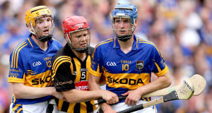 Tommy Walsh with Tipperary's Lar Corbett and Pa Bourke during the 2012 All-Ireland semi-final. Picture: INPHO/James Crombie