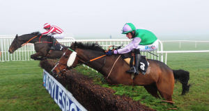 Home Farm  (David Casey, far side) jumps the last before going on to win the John Meagher Memorial Chase after  Hidden Cyclone (Andrew McNamara) fell. Picture: Healy Racing