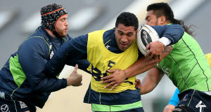 Connacht's Eoin McKeon and Mata Fifita tackle Mils Muliaina during training at the Sportsground this week. Picture: INPHO/James Crombie