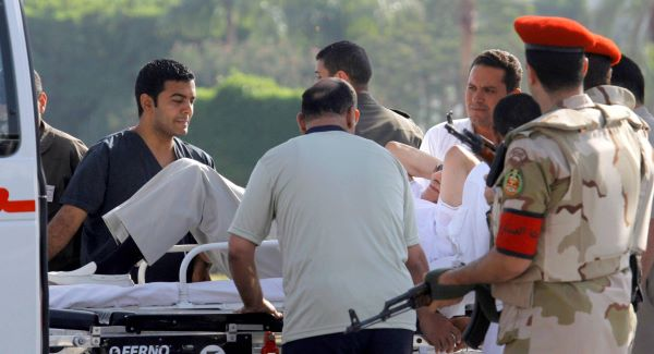 Hosni Mubarak, 85, is escorted into an ambulance at the Maadi Military Hospital yesterday. Picture: AP Photo/Amr Nabil