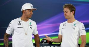 Mercedes drivers Lewis Hamilton, left, and Nico Rosberg, right, about to shake hands at a press conference yesterday. Picture: David Davies/PA