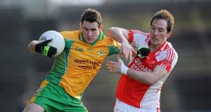 Corofin's Michael Farragher fends off Ballintubber's Alan Dillon in the 2011 Connacht Club SFC semi-final at McHale Park. Picture: Brian Lawless