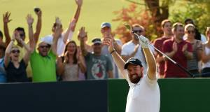 Shane Lowry celebrates his hole in one on the par-three 13th during the second round of the DP World Tour Championship in Dubai. Picture: Ross Kinnaird