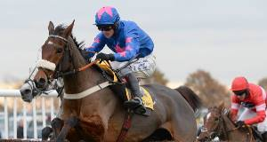 Cue Card and Joe Tizzard on their way to victory in the 2013 Betfair Chase at Haydock. He will defend his crown this afternoon. Pic: John Giles/PA