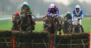 Closing Ceremony (centre) ridden by Daryl Jacobs lands in front of Milan Bound ridden by Richie McLernon to win The Brown Shipley Wealth Well Managed Handicap Race at Haydock yesterday. PA/Mike Egerton