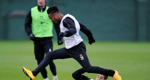 LEAP OF FAITH: Liverpool's Raheem Sterling and Javier Manquilo battle for the ball at Melwood. Picture: Andrew Powell