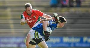 Paul Murphy, Kerry, in action against Michael Conroy, Mayo. Picture: Pat Murphy / SPORTSFILE