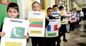 Signs of the times as pupils greet Education Minister Jan O'Sullivan at the North Presentation Primary School in Cork. She was welcomed to the school in 40 different languages.