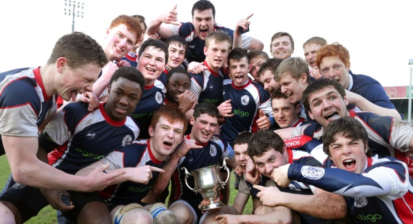 The Sligo Grammar team celebrate winning with the cup. Picture: INPHO