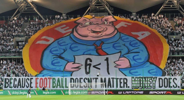 Legia Warsaw  supporters last night displayed a banner in protest at Uefa's decision to throw the club out of the Champions League for using an ineligible player in their 6-1 qualifier rout of Celtic.