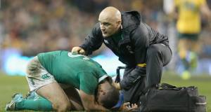 Rob Kearney gets treatment from Dr Eanna Falvey during Ireland's clash with Australia last weekend. Picture: Inpho/Colm O'Neill