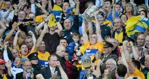 BANNER GOLD: Clare captain Patrick Donnellan lifts the Liam McCarthy cup after an epic replay battle with Cork at Croke Park.Picture: Brendan Moran