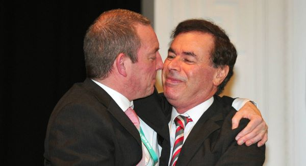 Justice Minister Alan Shatter hugs Cork TD Jerry Buttimer after the same sex marriage motion is passed.