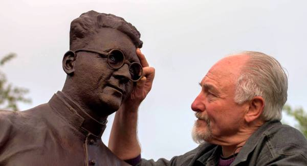Sculptor Alan Ryan Hall adjusting his bronze statue of Monsignor Hugh O'Flaherty. Picture: Don MacMonagle