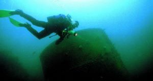 Diver from Gerry and Rianne Smyth's dive school passes one of the two boilers on the wreck of the Alondra, which ran aground in fog  on 29 Dec 1916 off Kedge Island, West Cork