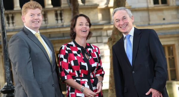 Ernst & Young Ireland  managing partner Mike McKerr, Ernst & Young Ireland partner Julie Fenton, and Minister for Jobs Richard Bruton at the announcement of 80 jobs at the company. Pic: Julien Behal