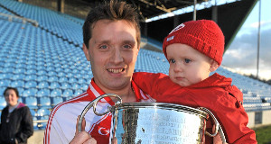 Ballintubber captain John Feeney celebrates with his 15 month old son, Christopher, at the end of the game. Mayo County Senior Football Championship Final.