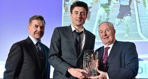 Mark English receives the Track and Field Athlete of the Year award from Athletics Ireland president Ciaran Ó Catháin, left, and Minister of State for Tourism and Sport Michael Ring at the National Athletics Awards