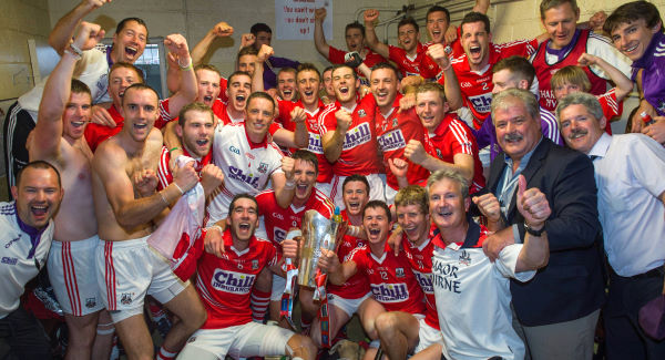 LARKING ON LEESIDE: Cork players and officials celebrate in the dressing room with the cup after defeating Limerick in the Munster SHC final at Páirc Uí Chaoimh. Picture: Ray McManus/Sportsfile