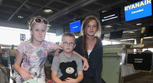 Chloe McCauley, Nathan Corcoran and Megan Corcoran at Dublin Airport. Their flight to Murcia was cancelled due to the strike by French air traffic controllers. Picture: Gareth Chaney/Collins