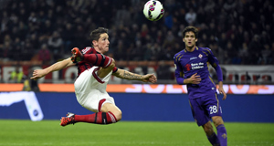 HIGH FLYER: AC Milan striker  Fernando Torres stretches for a volley during the Serie A claash with Fiorentina at the San Siro Stadium  on Sunday.