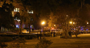Police investigate a shooting scene at Strozier Library on Florida State campus (AP Photo/Steve Cannon).
