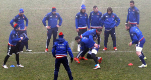 France work on their tackling during a training session at the National Rugby Centre in Marcoussis, south of Paris. Right: Camille Lopez during a media briefing. Picture: Christophe Ena.