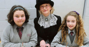 Gaelscoil Uí Riordain, Ballincollig, pupils Aoibhín Ní Fhloinn and Éabha Nic Dhomhnaill, both of whom had ancestors who survived the Lusitania sinking, with Sheila Foster of Cobh Animation Team with a model of the Lusitania made by Paul Frost.