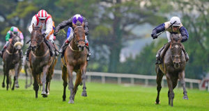 Artful Artist and Sean Corby (right) go on to win The Guinness Handicap. Picture: PA