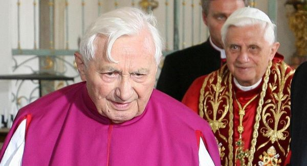 the Rev. Georg Ratzinger in front, with Pope Benedict XVI in the background. Pic: AP
