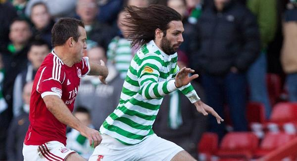 Aberdeen's Gavin Rae battles for the ball with Celtic's Georgios Samaras today. Picture: PA