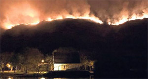 Firefighters monitoring fire at Gougane Barra; locals heard animal screams as they tried to escape