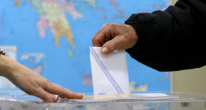 A man casts his vote at a polling station in Athens today. Pic: AP