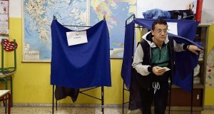 A man casts his vote at a polling station in Athens on Sunday. The far-left Syriza party of Alexis Tsipras came out on top and is poised to made radical changes to one of the recession's worst-hit countries.