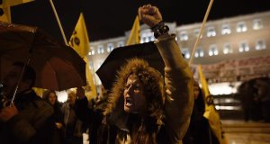 Anti-austerity protests in front of the parliament building in Athens. If Syriza wins the upcoming election it must moderate its approach: AP Photo/Kostas Tsironis