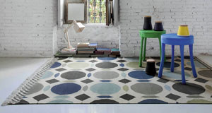 The Canada rug features clerical grey and charcoal detailing set against a white background. Flat hues of blue and teal add colour and interest (from €395 at LOMI)