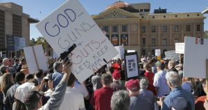 Gun rights supporters stand outside the Capitol in Phoenix, Arizona.Picture: AP