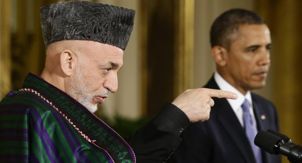 Afghan President Hamid Karzai takes questions from reporters during his joint news conference with President Barack Obama in the East Room at the White House in Washington today.Picture: AP