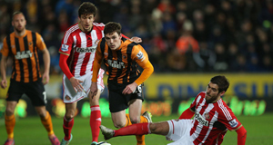 Hull City's Andy Robertson and Sunderland's Danny Graham battle for the ball.