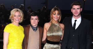 Jennifer Lawrence (third left) with 'Hunger Games' co-stars Elizabeth Banks, Josh Hutcherson and Liam Hemsworth at the film's London premiere last night.